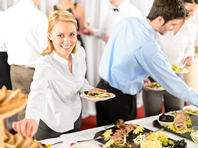 woman eating food from buffet